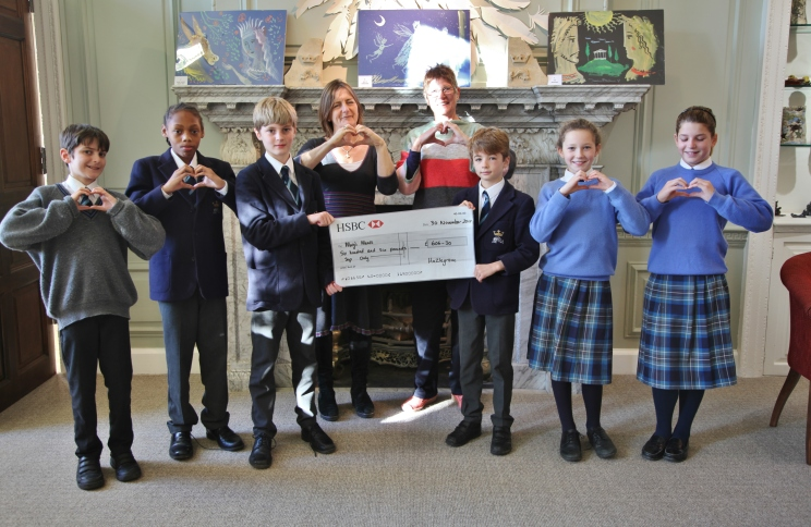 Ann White from Mary's Meals collecting the cheque